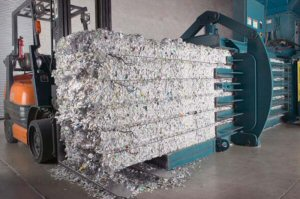 Preparing shredded material for recycling.