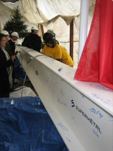 Ceremonial Topping-Off Beam Being Signed at Eighth Avenue Place