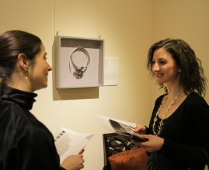 Guests admiring Mary Pickfords necklace at Homage Exhibit at Elmwood Spa, Toronto