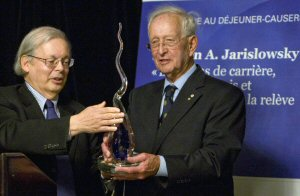 Mr. Yvan Allaire presenting the artwork to Mr. Jarislowsky in recognition of his performance of the past six decades. From Left to right: Mr. Yvan Allaire (Chairman of the Board of Directors, Institute for Governance of Private and Public Organizations), Mr. Stephen A. Jarislowsky (Chairman of the Board of Directors, Jarislowsky Fraser Limited)