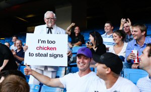 """Toronto - The original and world's most famous man in a white suit - KFC Colonel - chimed in on the recent """"sign stealing"""" baseball controversy at an August 12th game in Toronto.  As rumours circulated about an alleged """"man in a white suit"""" stealing signs in Toronto, KFC Colonel surprised baseball fans with a tongue-in-cheek sign of his own reading:  """"I'm too chicken to steal signs.""""  Photo courtesy KFC.ca"""