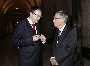 Ales Michalevic, pro-democracy leader and political exile from Belarus, talks to Canada's Minister of Natural Resources, Joe Oliver, in the Hall of Honour of Parliament after question period, Tuesday, November 22, 2011. Michalevic, who is on a Canadian speaking tour, will receive the John Humphrey Award from Rights & Democracy tonight. He is the first European to receive the award since it was created 20 years ago. The Canadian Press Images PHOTO/Rights & Democracy