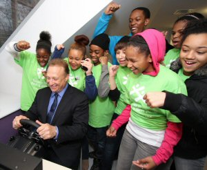 Regent Park youth cheer on donor Miles Nadal during the re-opening of the Toronto Kiwanis Boys & Girls Clubs, Miles and Kelly Nadal Centre, Thursday, January 26, 2012, in Toronto.  The Canadian Press Images PHOTO/Toronto Kiwanis Boys & Girls Clubs