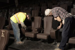 Workers put on the finishing touches during the seat installation in one of the VIP Cinema auditoriums at Cineplex Odeon Windermere and VIP Cinemas which opens April 20, 2012. (photo credit: Dean Ward, Highview Photo - Red Deer)