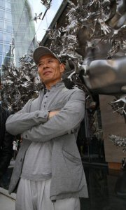 One of China's most influential living artists, Zhang Huan, stands in front of his permanent public sculpture, Rising, at its unveiling at Living Shangri-La in Toronto, Saturday, May 5, 2012. The large-scale exterior sculpture, which measures 21.98 x 19.8 x 4.8 metres, will permanently reside at the University Avenue entrance to Shangri-La Hotel, Toronto. The Canadian Press Images PHOTO/Living Shangri-La, Toronto