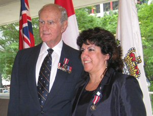 Amika Mobile CEO, Suhayya Abu-Hakima receiving the Queen Elizabeth II Jubilee Medal for being a technology visionary and tireless volunteer from the Honourable Henry Jackman, Former Lieutenant Governor of Ontario (Toronto, June 18, 2012)