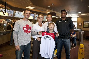 Elijah Porter (front), meets Jared Connaughton (left), and Seyi Smith (far right), of the Canadian men's 4x100 Olympic relay team at Andrea and Ray Rinelander's (centre), Tim Hortons in St. John's, Newfoundland, Tuesday, September 11, 2012. Elijah famously sent the Olympic relay team his Timbits soccer medal and an encouraging letter after they were disqualified during the London 2012 Games.   The Canadian Press Images PHOTO/Tim Hortons