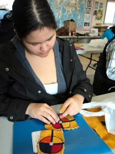 Webequie student creates her beaded moccasins