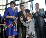 Six-year-old Hunter Kemp, a leukemia survivor, celebrates with a high five from lead donor Peter Gilgan at the grand opening celebration of the Peter Gilgan Centre for Research and Learning, Tuesday, September 17, 2013, in Toronto. Mary Jo Haddad, president and CEO, The Hospital for Sick Children, and Tim Hockey, President, TD Canada Trust and Campaign Chair, look on.  The Canadian Press Images PHOTO/SickKids Foundation