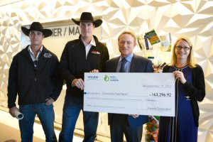 (Pictured from left to right) Chad Fike, Driver and Outrider; Jordie Fike, Driver; Michael G. McAllister. Executive Vice-President, Encana Corporation & President, Canadian Division; Julie Brewster, Calgary Food Bank