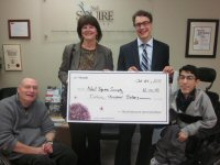 TELUS presents cheque for $12,000 at the Neil Squire Society - The photo includes Gary Birch, Joanne Curry, Chad Leaman, Milad Hajihassan