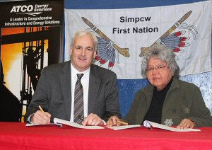 ATCO Energy Solutions President Patrick Creaghan and Chief Rita Matthew of the Simpcw First Nation sign a Relationship Agreement in Barriere, British Columbia.