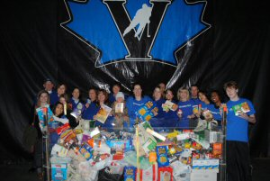 Valley First employees and volunteers with food donations collected at a recent Feed the Valley-sponsored British Columbia Hockey League game.