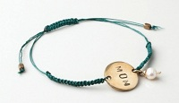 With the purchase of each Me to We Artisans' Neno Mom Bracelet DHL will donate $5 to provide a mother and child in a Free The Children community overseas with one health clinic visit.