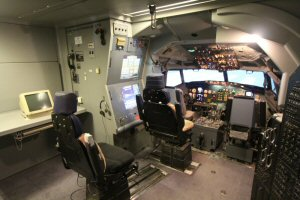 Trainer seat near cockpit of the simulator