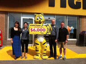 Seen in the picture from right to left is Brad Crossely, Scott Gouthro from Giant Tiger, Friendly, the Giant Tiger, Patty Gouthro from Giant Tiger, and Jay Rawding from Autism Nova Scotia.