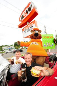 Paul Hollands (right), President and CEO, A&W Food Services of Canada Inc., and Yves Savoie, President and CEO, Multiple Sclerosis Society of Canada join the Great A&W Root Bear(R) to kick-off the 6th annual Cruisin' to End MS event, Wednesday, August 20, 2014, in Kitchener, Ontario. On August 21, 2014 $1 from every Teen Burger(R) sold across Canada will go towards helping those living with MS. MARKETWIRED PHOTO/A&W Food Services of Canada Inc.