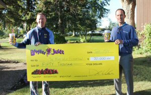 Dale S. Wishewan, President & CEO of Booster Juice, presents cheque for $50,000 to Mike Weir for The Mike Weir Foundation