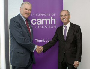 Toronto Philanthropist Andrew Faas (right) shakes hands with the Hon. Michael Wilson, Honorary Chair of CAMH Foundation's $200 million Breakthrough Campaign, the world's largest fundraising campaign for a mental health hospital, after presenting him with a $1-million gift Thursday, October 23, 2014, in Toronto.  The Canadian Press Images PHOTO/Faas Foundation