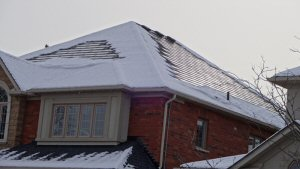 DOW POWERHOUSE(TM) solar shingles generating energy even in cold climate