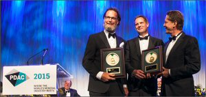 Robert Friedland (right) presenting the Thayer Lindsley Award to two members of the Kamoa Discovery Team - Dr. David Broughton (left) and Thomas Rogers (centre).
