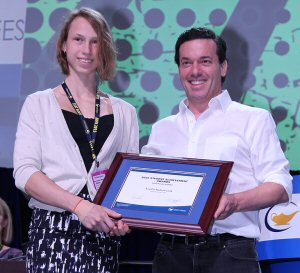 Cawthra Park SS student Emilia Radziwonik, is the winner of a 2015 OSSTF/FEESO Student Achievement Award. Seen here presenting Radziwonik (left) with her award is OSSTF/FEESO's Guest Speaker, Joseph Boyden, Canadian Novelist.