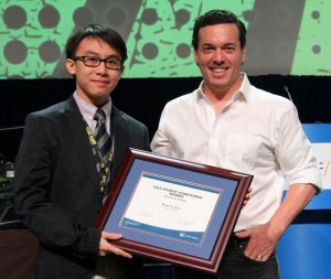 Shun Yu Rao, student at Colonel By SS, is the winner of a 2015 OSSTF/FEESO Student Achievement Award. Seen here presenting Yu Rao (left) with his award is OSSTF/FEESO's Guest Speaker, Joseph Boyden, Canadian Novelist.