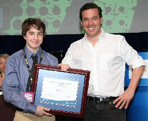 Académie catholique Ange-Gabriel student Tristan Gill is the winner of a 2015 OSSTF/FEESO Student Achievement Award. Presenting Gill (left) with his award is OSSTF/FEESO's Guest Speaker, Joseph Boyden, Canadian Novelist.