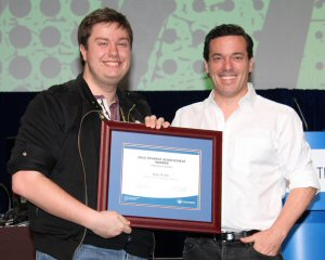 Ajax High School student John Welsh is the winner of a 2015 OSSTF/FEESO Student Achievement Award. Welsh (left) was presented with his award by OSSTF/FEESO Guest Speaker, Joseph Boyden, Canadian Novelist.