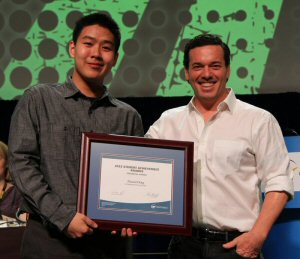 Markham DHS student Daniel Ding, is the winner of a 2015 OSSTF/FEESO Student Achievement Award. Presenting Ding (left) with his award is OSSTF/FEESO's Guest Speaker, Joseph Boyden, Canadian Novelist.