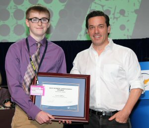 Goderich DCI student Curtis Jeffrey (left), is the winner of a 2015 OSSTF/FEESO Student Achievement Award. Jeffrey is seen here being presented with her award by OSSTF/FEESO's Guest Speaker, Joseph Boyden, Canadian Novelist.