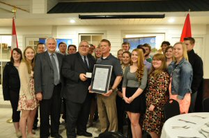 MP Preston presents a 2015 National Recreational Fisheries Award to East Elgin Secondary School's Environmental Leadership Program (front row, second from left: Kim Smale, Catfish Creek Conservation Authority; front row, holding the medallion box: Joe Preston, Member of Parliament for Elgin-Middlesex-London; front row, holding the framed certificate: Duncan Sinclair, Jr., teacher-delegate of the Program)