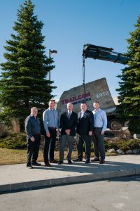 Trailcon Leasing moved its iconic rocks to its new facility in Brampton. Pictured (left to right) are Mick Crowe, Mike Krell, Alan Boughton, John Foss, and Bryan Burningham.