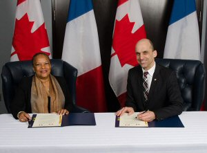 Christiane Taubira, France's Keeper of the Seals and Minister of Justice and the Honourable Steven Blaney, Canada's Minister of Public Safety and Emergency Preparedness sign a Declaration on the Cooperation Program between the Department of Public Safety and the Ministry of Justice of the French Republic in Ottawa on April 23, 2015.