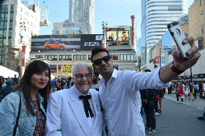 Colonel Sanders takes a selfie with KFC fans in Toronto's Yonge-Dundas Square to promote his new Canadian meal deal $5 Fill Ups! Check out Facebook.com/KFCCanada for daily contests KFC is hosting to help their fans #FillUpFor5.