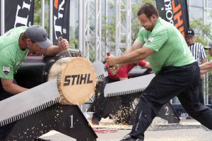 Marcel Dupuis of Memramcook, N.B., (right) powers through a log in the single buck event on his way to winning his first STIHL Timbersports Canadian Championship at the Scotiabank Convention Centre in Niagara Falls, Ontario, Sunday, July 19, 2015. The Canadian Press Images PHOTO/STIHL Timbersports
