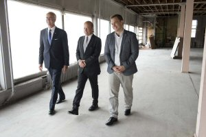 Hartley Richardson, President & CEO of James Richardson and Sons (from left to right), David Aisenstat, President and CEO, The Keg Steakhouse and Bar, and Marc Kielburger, co-founder of Free The Children, walk together in the future home of the Global Learning Centre, Tuesday, October 27, 2015, in Toronto.  The facility will transform service-learning opportunities for millions of students in Canada and around the world. The Canadian Press Images PHOTO/Free The Children