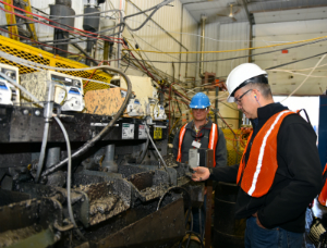 AGC President and CEO Donald Baxter inspects Coosa graphite concentrate at the flash flotation stage during the Coosa Graphite Project Pilot Plant at SGS Mineral Services in Lakefield, Ontario.  Credit: Alabama Graphite Corp.