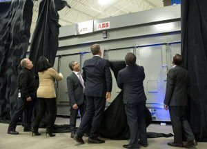 Fadi Emeid (centre, with glasses), President & CEO of Elias Custom Metal Fabrication Ltd; Sam Emeid; City of Vaughan Mayor Maurizio Bevilacqua; MP Francesco Sorbera; Councillor Sandra Racco; and Steve Chomyc from ABB, unveil a 60,000 pound and 1,100 square foot E-house, the first ever to be manufactured in Ontario, at an event in Vaughan, Friday, March 4, 2016.  The Canadian Press Images PHOTO/ Elias Custom Metal Fabrication Limited