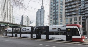 PATTISON Outdoor Advertising and the Toronto Transit Commission (TTC) reveal the transit system's first fully wrapped Flexity Streetcar introducing the all-new Volvo XC90. Photo Credit: Jake Fry
