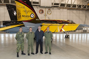 Left to Right: Chief Warrant Officer (CWO) Alain Roy, the 4 Wing Cold Lake's CWO, Colonel Eric Kenny, 4 Wing Cold Lake's Base Commander, Mr. Jim Belliveau, design and paint crew lead, and Captain Ryan Kean, the CF-18 Demonstration pilot, during the CF-18 Demonstration Jet unveiling ceremony held at Hangar 2, 4 Wing Cold Lake, Alberta, on April 5, 2016. Image by: Cpl Bryan Carter, 4 Wing Imaging, CK04-2016-0278-004