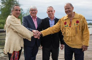 Aboriginal Equity Partner Stewards David MacPhee (left), Elmer Ghostkeeper (2nd from left), and Bruce Dumont (far right) stand with Northern Gateway President John Carruthers (2nd from right) in Vancouver, Tuesday, May 3, 2016, following their joint signing of Northern Gateway's application to the National Energy Board for an extension to the Project's Sunset Clause.  The Canadian Press Images PHOTO/Northern Gateway and Aboriginal Equity Partners