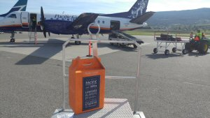 Pacific Coastal Airlines' sleek new wine box ready for loading at Kelowna International Airport. The box full of wine will fly for free under the airline's fifty pounds of free checked baggage policy.