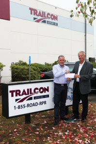 Randy Drake (left) of Stewart Trailers and Alan Boughton of Trailcon Leasing commemorate the first days of Stewart Trailers operating as Trailcon.