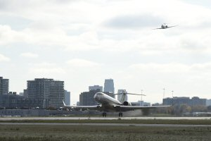 The Bombardier Global 7000 aircraft takes off on first flight in Toronto with chase plane in background