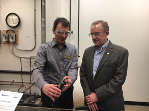 Mark Hiseler, vice president, Suncor refinery receiving a demonstration of the wireless monitoring technology at Lambton College.