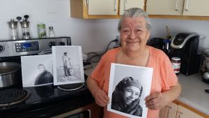 In December 2015, Johnny Kasudluak and his mother, Martha Kasudluak, discovered several photographs of Martha and other family members from Inukjuak, Quebec. They sent this photo of Martha with three photographs of her as a young woman. Photo courtesy of Johnny Kasudluak. Black-and-white photo by Richard Harrington (LAC / PA-147066).