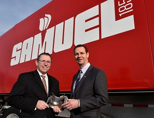 Samuel Manufacturing President Colin Osborne (right) and Peter Adams, President Burloak Technologies, are shown in Burlington, Ont., Thursday, March 2, 2017, holding a component produced with Burloak's additive manufacturing, 3D metal printing technology. Samuel will acquire Burloak Technologies as part of an industry-first agreement announced today, Tuesday, March 7, 2017.  MARKETWIRED PHOTO/Samuel, Son & Co., Limited
