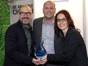 CIPH Board Member Matt Robinson presents the Water Wise Award to Pierre Lussier, Director at Jour de la Terre (left) and Anne-Helene Lavoie, Communications Director, Sobeys Quebec at MCEE 2017 in Montreal.