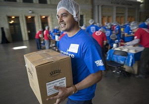 Accenture employee Suraj Bhardwaj adds a box of hunger relief packages to the pile of 15,200 pounds of food packed and donated to the Daily Bread Food Bank during Accenture's annual employee meeting in Toronto, Ont., Friday, June 16, 2017.   A total of 100,000 meals and $10,000 were donated by Accenture. The Canadian Press Images PHOTO/Accenture